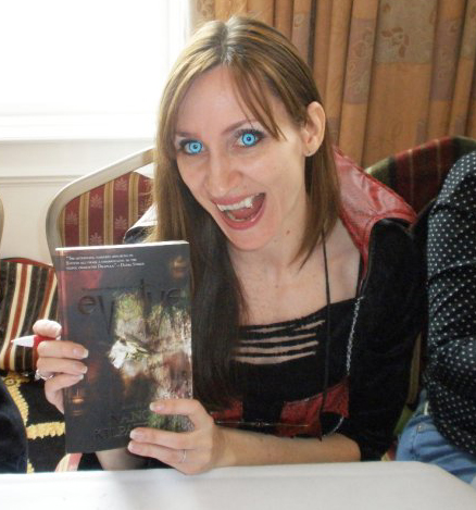 Sandra Wickham signing Evolve wearing blue vampire contact lenses