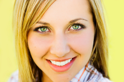 woman wearing green contacts toric lenses